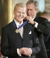Paul Harvey receiving the Medal of Freedom in 2005