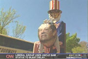 Uncle Sam whacking Tom DeLay figure on head