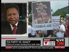 Rev. C. L. Bryant, Tea Party Member; & Obama as witch doctor poster from 2009 9/12 Tea Party rally in Washington, DC | NewsBusters.org